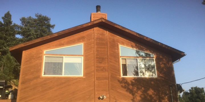 Image of conifer home after window replacement